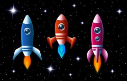 Three brightly colored rockets in outer space Royalty Free Stock Image