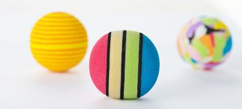 Three Brightly Coloured Foam Balls Isolated. Royalty Free Stock Photo