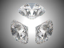 Three brilliant cut diamonds Stock Images