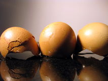 Three broken eggs Stock Photos