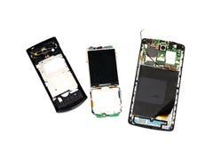 Three broken phones on a white background stock photos
