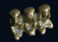 Three bronze monkeys. Three monkeys figurine - not to speak not to see not to hear royalty free stock photos