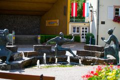 Three bronze statues of musicians playing some instruments with a fountain in the middle in Vianden, Luxembourg. Vianden. International Music Festival and royalty free stock photography