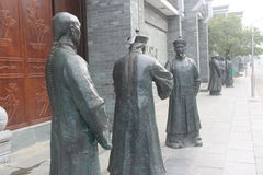 Three bronze statues of officials in the Qing Dynasty Royalty Free Stock Image