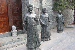 Three bronze statues of officials in the Qing Dynasty Stock Image