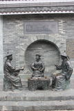 Three bronze statues of officials in the Qing Dynasty Royalty Free Stock Photo