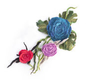 Three brooches from felted wool. On a white background Stock Photos