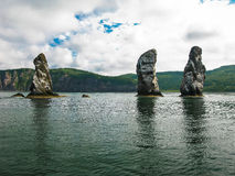 Three brother rocks, Avacha bay, Kamchatka peninsula Russia. Three brother rocks, Avacha bay Kamchatka peninsula, Russia royalty free stock images
