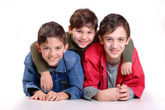 Three brothers. In the embrace of a white background Stock Photography