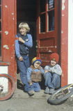 Three brothers in a doorway in Paradise, MT Stock Image