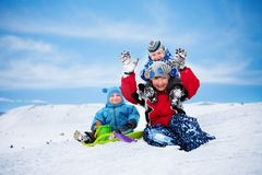 Three brothers having fun on winter day Royalty Free Stock Photos