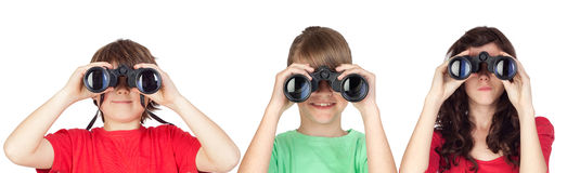 Three brothers looking for binoculars Stock Photos