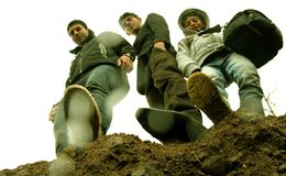 Three brothers on a mountain Stock Images