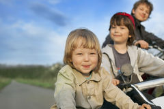 Three brothers ride bikes Royalty Free Stock Photos