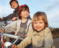 Three brothers ride bikes Stock Photo