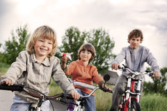 Three brothers ride bikes Royalty Free Stock Image