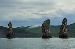 Three Brothers Rocks in the Avacha Bay of Pacific Ocean. Coast of Kamchatka. Three Brothers Rocks in the Avacha Bay of the Pacific Ocean. The coast of Kamchatka royalty free stock image