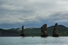 Three Brothers Rocks in the Avacha Bay of Pacific Ocean. Coast of Kamchatka. Royalty Free Stock Photos