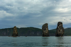 Three Brothers Rocks in the Avacha Bay of Pacific Ocean. Coast of Kamchatka. Royalty Free Stock Image