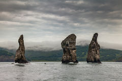 Three Brothers Rocks in the Avacha Bay of the Pacific Ocean. The coast of Kamchatka. Three Brothers Rocks in the Avacha Bay of the Pacific Ocean. The coast of Royalty Free Stock Images