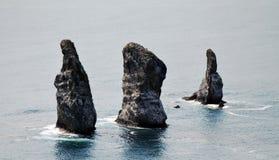 Three brothers. (three rocks) in Avacha Bay (Pacific ocean) in Kamchatka Royalty Free Stock Photo