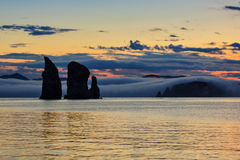 Three Brothers Rocks in Avacha Bay at sunset. Kamchatka Stock Photos