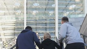 Three brothers running upstairs to stadium, football fans, supporting team. Stock footage stock footage
