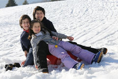 Three brothers on the snow in the mountains Stock Image