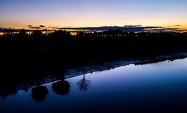 The Three Brothers. Under the night, the trees play with their reflection  in the blue water of the river. Newry Road, Dundalk, County Louth, Ireland, Europe Stock Images