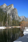 Three Brothers in Yosemite National Park. The Three Brothers loom over the Merced River in Yosemite National Park royalty free stock photography