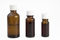 Three browm medical bottles Stock Images