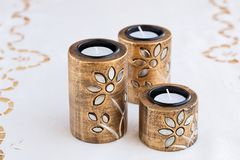 Candles. Three brown ancient style candle nests on cloth background Royalty Free Stock Image
