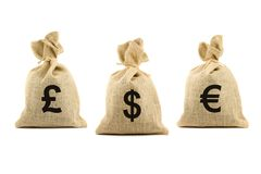 Three brown bags with currency symbols. Three bags with dollar, pound and euro symbols. Isolated on white Stock Image