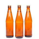 Three brown beer bottle. With drops drink without label on a white background Royalty Free Stock Photography