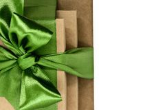 Three brown carton gift boxes bundled with green ribbon isolated on white background and view from above.  royalty free stock photos