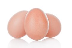 Three brown chicken eggs Stock Images