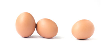 Three brown chicken eggs. Royalty Free Stock Photography