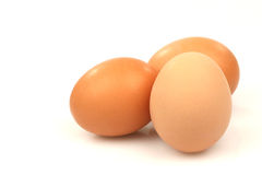 Three brown eggs. On a white background Royalty Free Stock Image