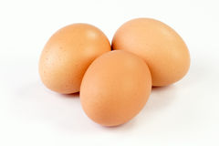 Three brown eggs Stock Photo