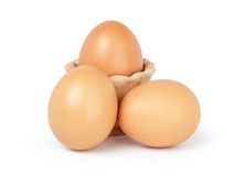 Three brown eggs isolated Stock Photos