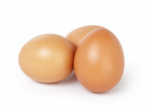 Three brown eggs isolated Royalty Free Stock Photography