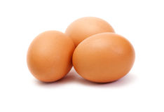 Three brown eggs on white background Royalty Free Stock Image