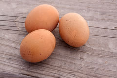 Three Brown Eggs on a Wooden Background Royalty Free Stock Photo
