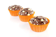 Three brown homebaked cupcake Royalty Free Stock Photos