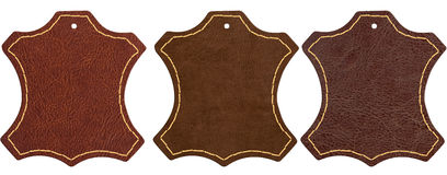 Three brown leather signs on white background Stock Images