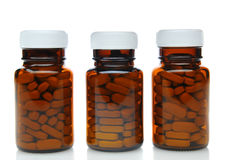 Three Brown Medicine Bottles Royalty Free Stock Images