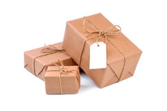 Three brown packages Stock Photos