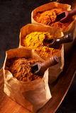 Three brown paper bags filled with ground spice Royalty Free Stock Photography
