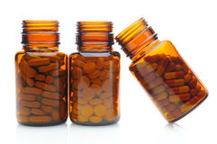 Three Brown Pill Bottles Royalty Free Stock Photos