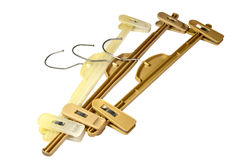 Three Brown Plastic Coat Hangers With Metal Hooks Royalty Free Stock Images